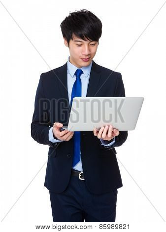 Young business man using laptop