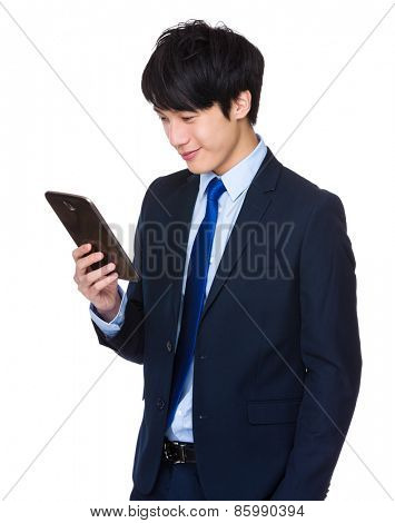 Chinese businessman with a tablet computer