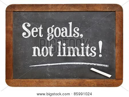 Set goals, no limits. Motivational words  on a vintage slate blackboard