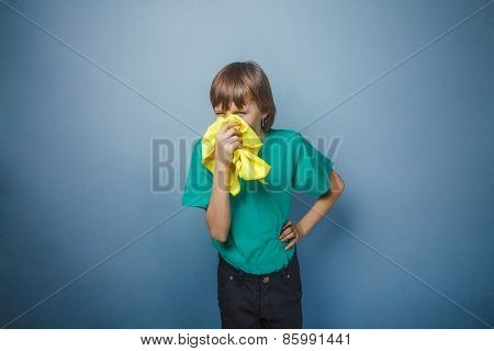 Boy, teenager, twelve years in a green t-shirt, handkerchief