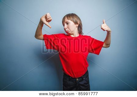 Boy, teenager, twelve years in red shirt showing sign of Yes