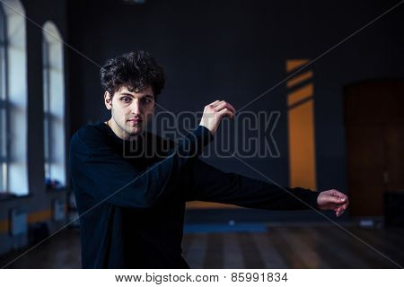 Handsome young man dancing at gym
