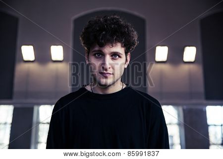 Portrait of a handsome man with curly hair