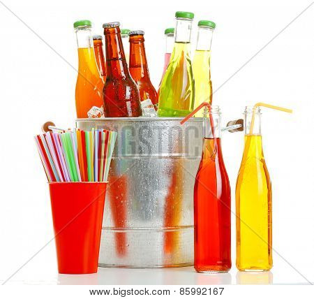 Glassware of different drinks in metal bucket isolated on white