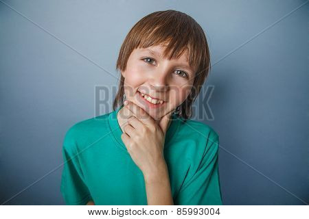 Boy, teenager, twelve years a in  green t-shirt , looking away,