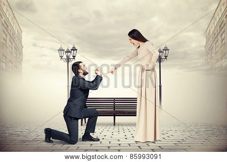 emotional man crying and looking at screaming woman. photo on foggy street