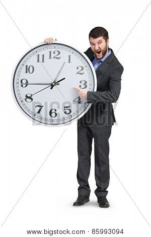 yelling businessman pointing at clock. isolated on white background