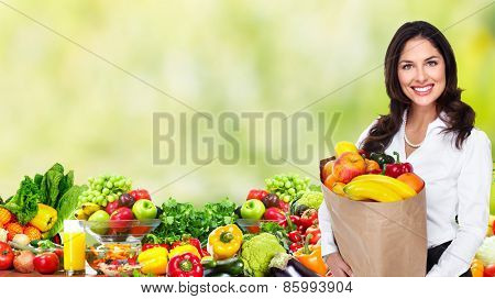 People with Vegetables over green background. Healthy diet.