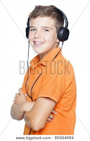 Smiling boy in headphones listening to music, isolated on white background