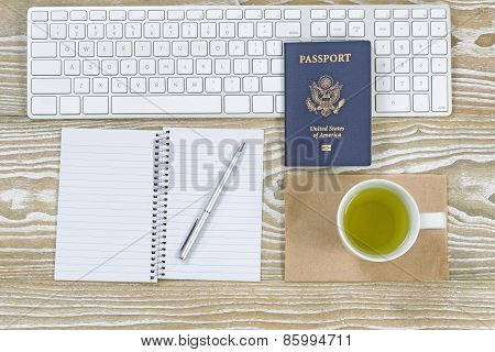 Office Desktop With Usa Passport And Green Tea