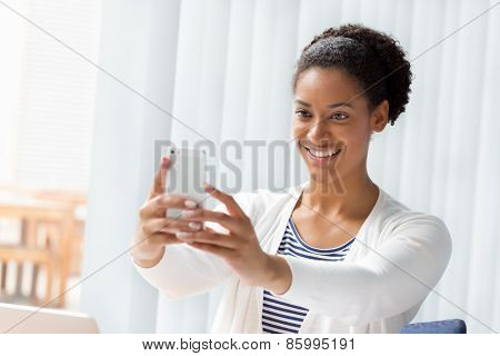 Woman taking a picture of herself with a phone