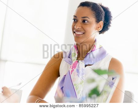 Young business lady in an office