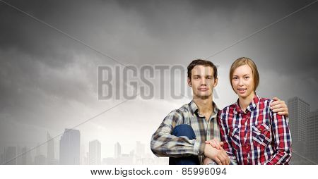 Young happy couple hugging each other tenderly