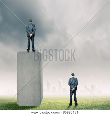 Rear view of businessman standing on bar