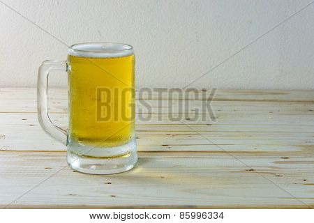 Still Life With Beer In A Glass On Wooden Table Background.