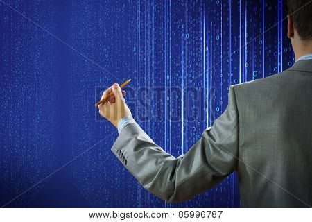 Rear view of businessman touching digital screen