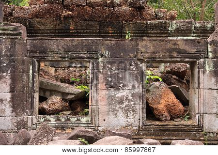 Closeup Of Ruined Wall With Windows Of An Ancient Khmer Temple
