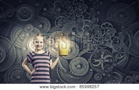 Cute girl of school age holding yellow bucket