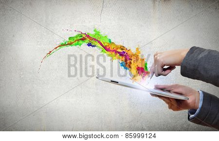 Close up of human hands holding tablet pc