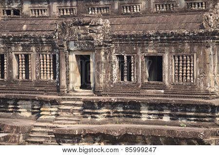 Wall With Stone Carved Decoration Of Ancient Khmer Temple