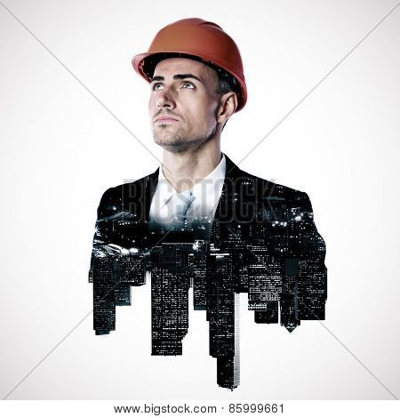 Double exposure of a city and architect looking up over white background