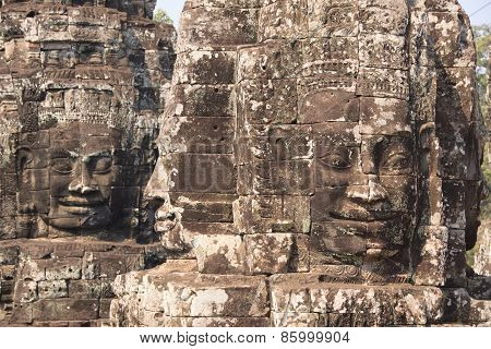Four Sides Stone Faces Of Bayon Temple In Angkor - Khmer Ancient Town