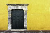 picture of hasp  - Yellow colonial style wall in the ancient city of cartagena in Colombia - JPG