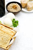 picture of matzah  - Matzah wine eggs chicken greens and haroset on a white background traditional food for the Pesach - JPG