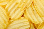 stock photo of potato chips  - closeup of potato chips for background use full frame - JPG