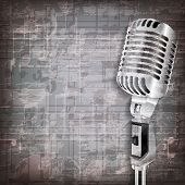 picture of music symbol  - abstract grunge gray music background with retro microphone - JPG