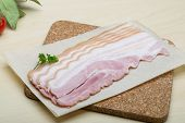 stock photo of bacon strips  - Raw Bacon strips on the wood background - JPG