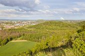 picture of slag  - View from a slag heap over green forest and a former coal mine in west Germany near Aachen to a distant coal - JPG