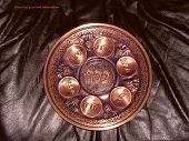 pic of seder  - Seder plate on black leather background above is a space for your text - JPG