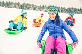 stock photo of sled  - Friends driving sleds on snow  - JPG