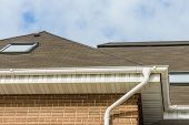 foto of downspouts  - chimney on the roof of the house against the blue sky - JPG