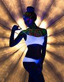 stock photo of uv-light  - Image of seductive slender girl dancing in neon light - JPG
