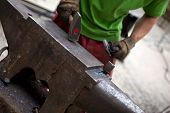 picture of anvil  - Blacksmith and his anvil in a workshop