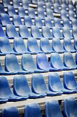 picture of tribunal  - Empty blue seats on sport arena tribune after the rain - JPG