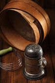 foto of flour sifter  - Vintage  Baking Tin cutters on metal backdrop - JPG