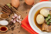 """image of pork  - """"eggs and pork stewed in the gravy"""" or """" eggs and pork in brown sauce"""" are the traditional thai food style. - JPG"""