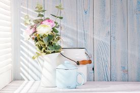 foto of louvers  - Morning still life on shabby chic table and light from the blinds - JPG