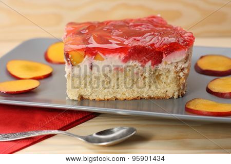 Strawberry And Peach Cake With Gelatin On Grey Plate On Wooden Table