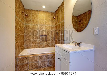 Elegant Bahroom With Rustic Feel And Large Bathtub.