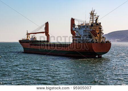 Cargo Ship Sailing In Ocean