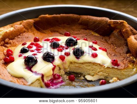 pudding with frozen berries and vanilla sauce
