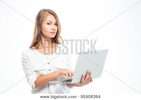 Beautiful young woman standing with laptop isolated on a white background. Looking at camera