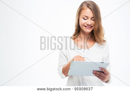 Happy female student using touch pad isolated on a white background