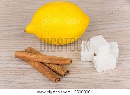 Lumps Of Sugar, Cinnamon Sticks And Lemon On Table
