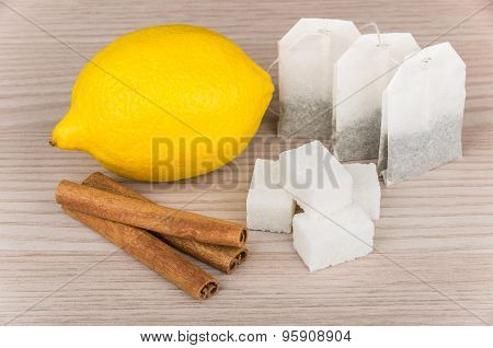 Lumps Of Sugar, Cinnamon Sticks, Lemon And Packets Of Tea