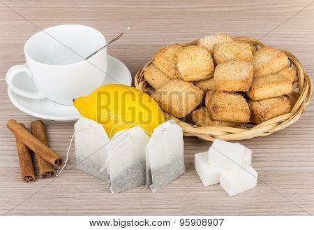 Sugar, Cinnamon, Lemon, Packets Of Tea And Cookies In Basket